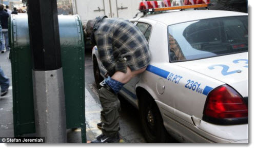 ows member crapping on a police car