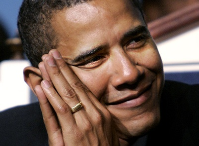 Barack Obama showing his gold band with Muslim praise of Allah
