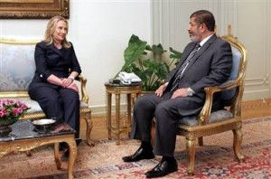Hillary Clinton visiting Mohamed Morsi, Nov. 22, 2012