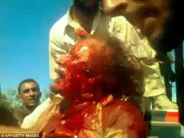 Qaddafi murder in process