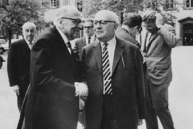 "Per tabletmag.com: ""Max Horkheimer (left) and Theodor Adorno (right), with Jürgen Habermas and others in the background, right, in 1965 at Heidelberg. (Wikimedia Commons)"""