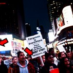 """Revolutionary Communist Party signs at """"Ferguson"""" protest"""