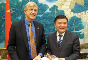 NIH Director Dr. Francis Collins exchanged gifts with Chinese Minister of Health Chen Zhu during his visit to Beijing.